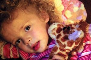Sara and stuffed toy giraffe